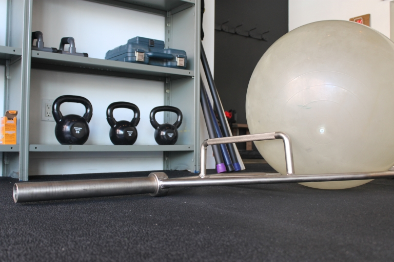 Kettlebells, balance ball, and hex bar