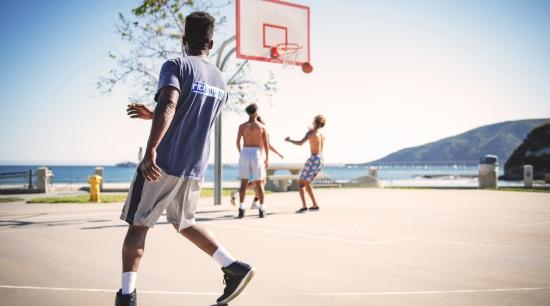 Cardio workout: guys playing basketball. Image credit: Tim Mossholder / Pexels