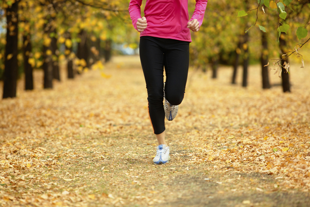 Woman running in fall leaves / Image source: christianacare.org