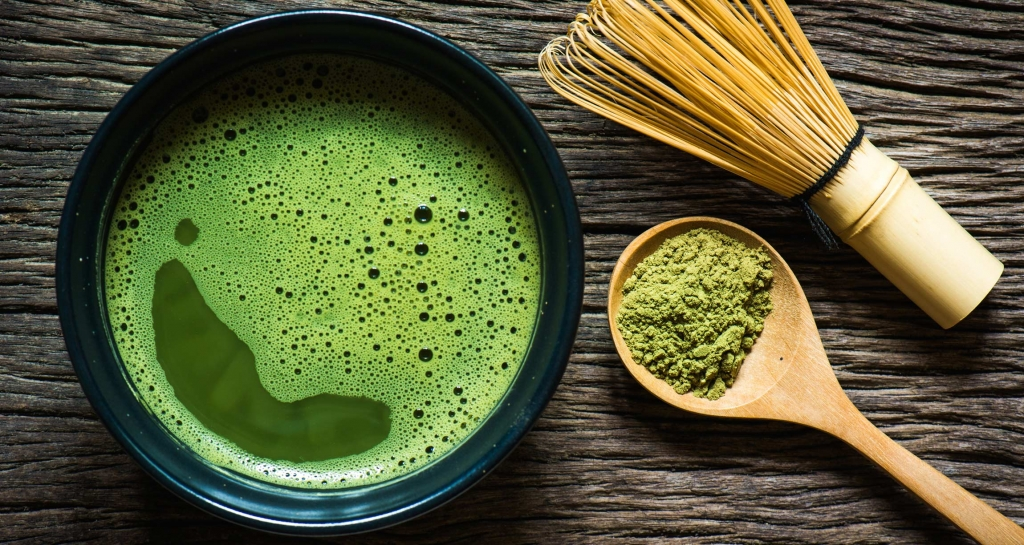 Matcha with spoon and whisk