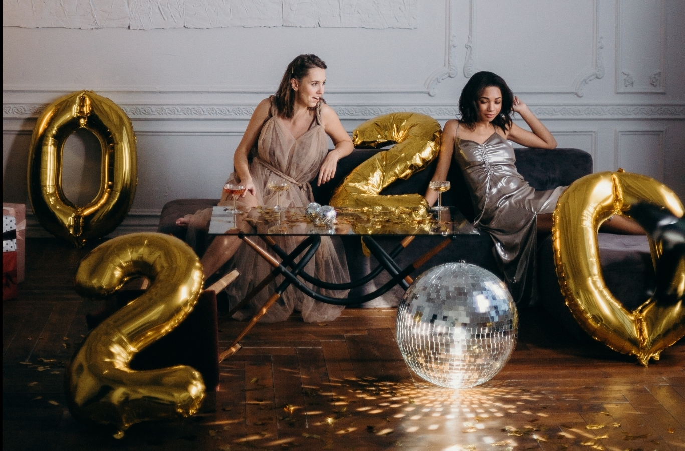 women on couch at New Year's party / Photo by cottonbro from Pexels
