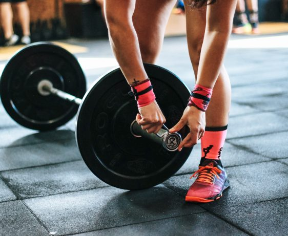 Adding weight to barbell - Freelance trainers background image